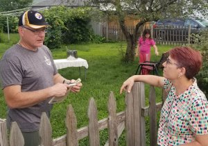 Abby Tilsner, Socialist Workers Party candidate for Albany County Executive, speaks with Christopher Conroy, a truck driver, about party's program in Waterford, New York, Aug. 24.