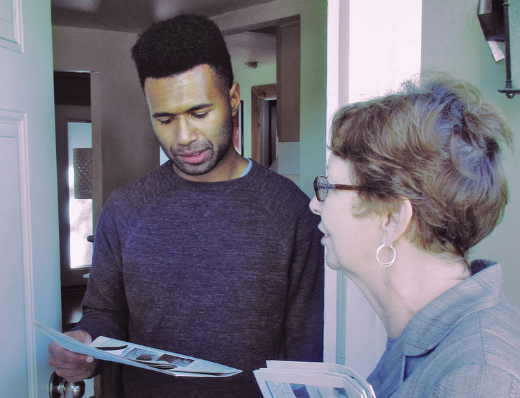 """Alyson Kennedy, Socialist Workers Party presidential candidate in 2016, talks to Markus Nalumu in Burien, Washington, Sept. 10. """"I commend you for what you're doing,"""" he said."""