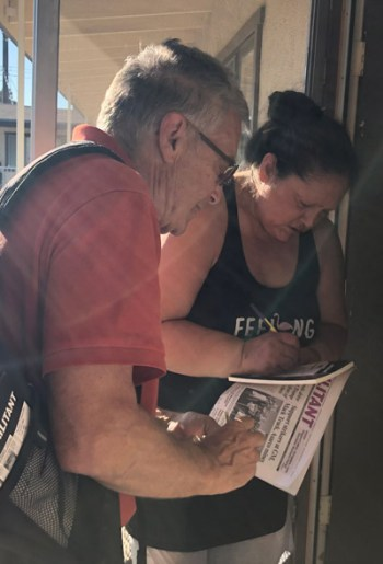 Gloria Saenz purchases subscription to Militant Oct. 26 after discussing Asarco copper miners strike with SWP member Bernie Senter on her doorstep in Whittier, California.