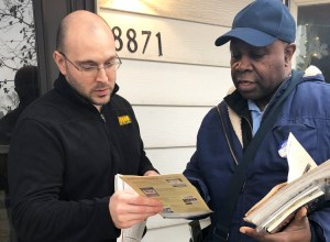 SWP member Leroy Watson, right, talks to Joshoa Gantile on his doorstep in Hometown, Illinois, Dec. 8. SWP says workers need to build a labor party to defend our class interests.