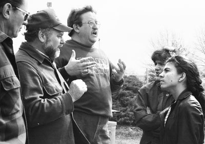 Kenia Serrano, right, leader of Cuba's Federation of University Students, talks with striking UAW members at Caterpillar plant in York, Pennsylvania, during U.S. speaking tour by Serrano and Rogelio Polanco in 1995. The Cuban youth learned about U.S. class struggle and explained example of Cuba's socialist revolution to workers.