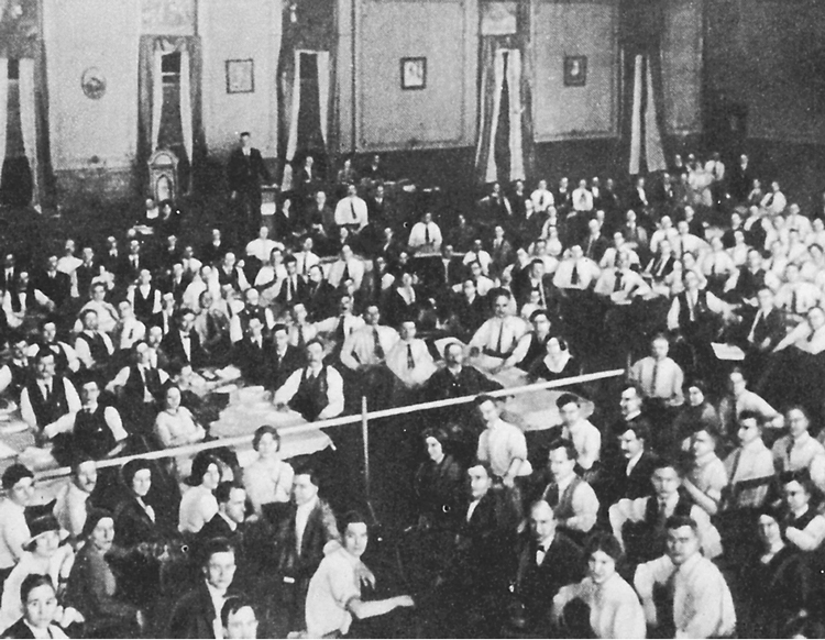 "Above, delegates at 1919 founding convention of U.S. Communist Party. Degeneration of the party began after early years, Cannon said, ""when it abandoned perspective of revolution in this country"" and became ""a cheering squad for the Stalinist bureaucracy in Russia."""