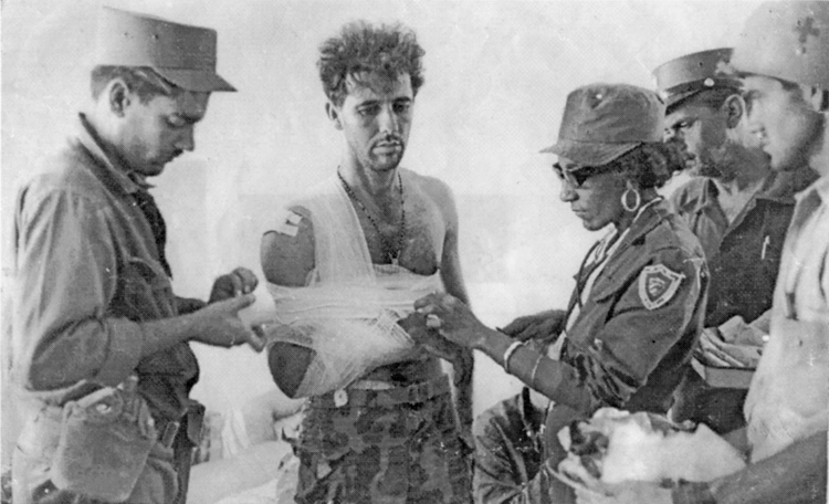 Wounded mercenary is treated after capture at defeated U.S.-backed Bay of Pigs invasion, 1961. Even before the revolution, July 26 Movement provided medical care equally to workers, peasants, its own combatants and enemy soldiers. Today health care is freely available to all.