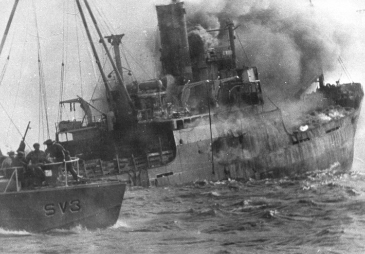 At Bay of Pigs in April 1961, U.S. transport ship Houston, carrying counterrevolutionary invaders, was sunk by fledgling Cuban revolutionary air force. Inset, Enrique Carreras led the pilots in action.