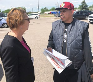 """SWP presidential candidate Alyson Kennedy speaks with Angel Bernal during shift change at JBS meatpacking plant in Greeley, Colorado. """"Slowing down line speed should be permanent,"""" Kennedy said. """"Workers need to take control of production to ensure safe working conditions."""""""