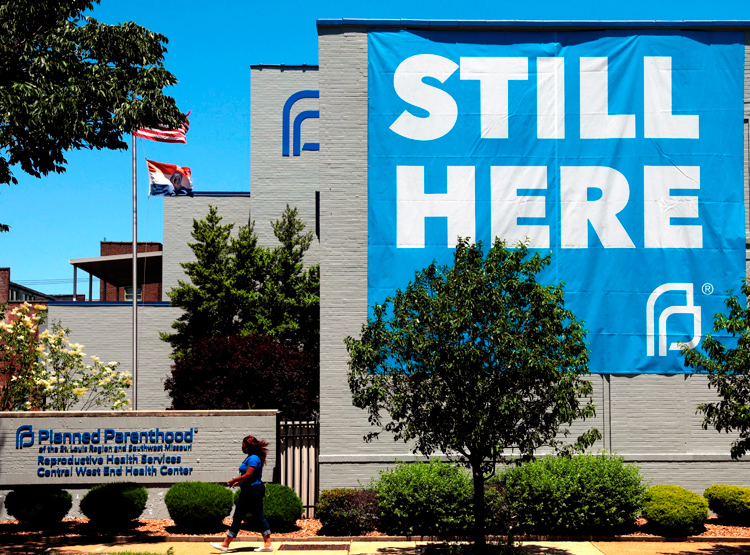 St. Louis Planned Parenthood, only clinic open in Missouri for women who choose to have an abortion, hangs huge banner May 29 after defeat of state officials' move to shut it down.