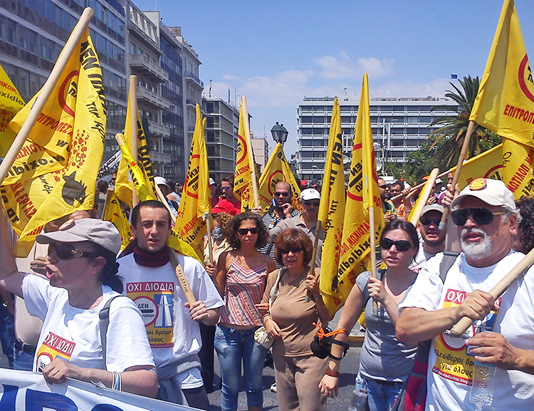 "Public power workers contingent at June 2011 protest in Athens against government attacks on unions, layoffs demanded under terms of Berlin-led EU ""bailout."" Growing capitalist crisis today, worsened by pandemic, is deepening rivalries and rifts among Europe's capitalist rulers."