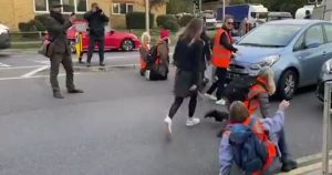 Watch: Drivers Drag Environmental Protesters Out of the Road During Protest