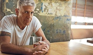 Anthony Bourdain accused of being taller than expected.