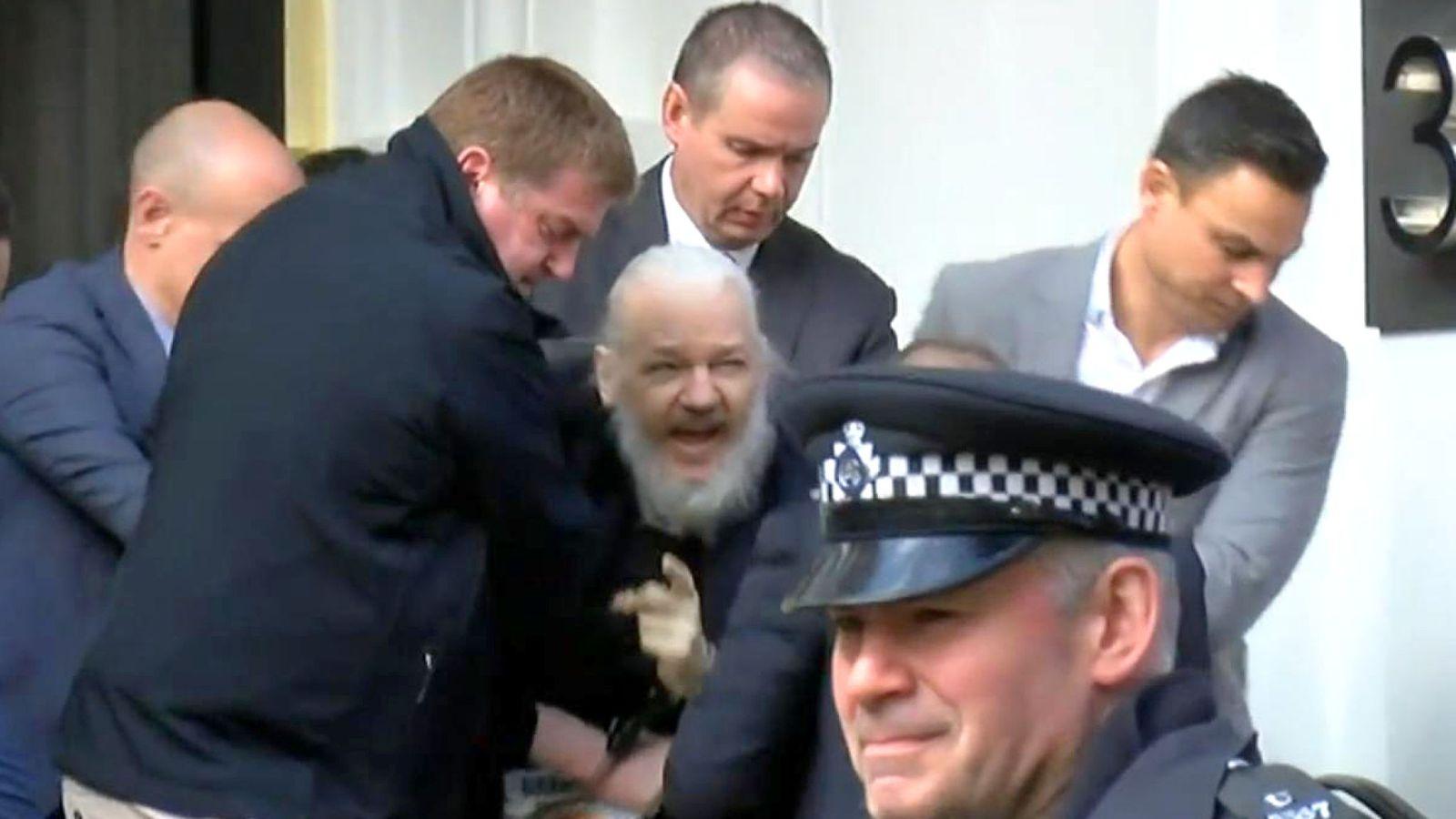 https://i2.wp.com/themillenniumreport.com/wp-content/uploads/2019/04/skynews-julian-assange-arrested_4635825.jpg