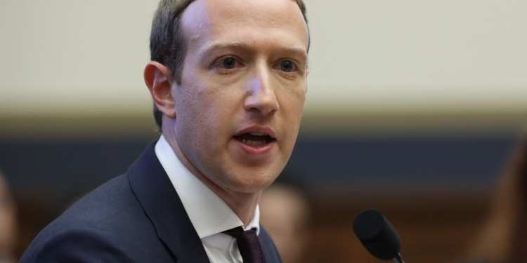 Companies pull advertising from Facebook as Zuckerberg faces biggest backlash yet