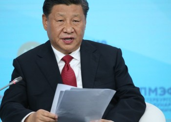 China increases its involvement in private business, leading critics to question its motives