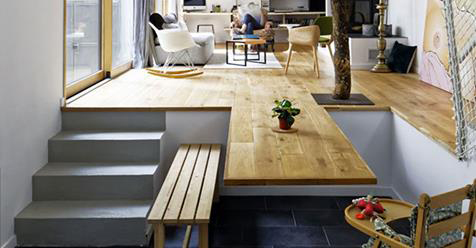 Modern Parisian Apartment's Hardwood Floor Seamlessly Doubles as a Kitchen Table