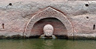 600-Year-Old Buddha Emerges From The Lake In China