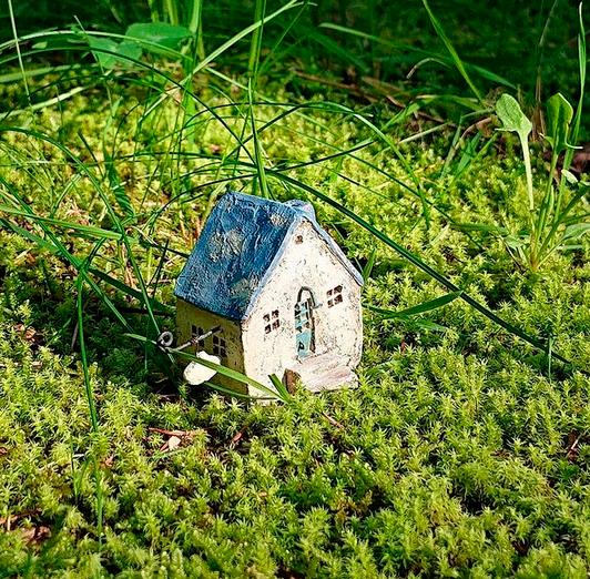 Tiny miniature house on grass