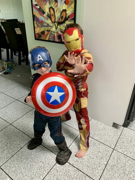 Two little boys dressed up as Iron Man & Captain America