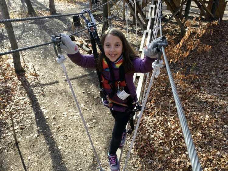 A little girl at Adventure Park Long Island. Zipline & Ropes Courses on Long Island