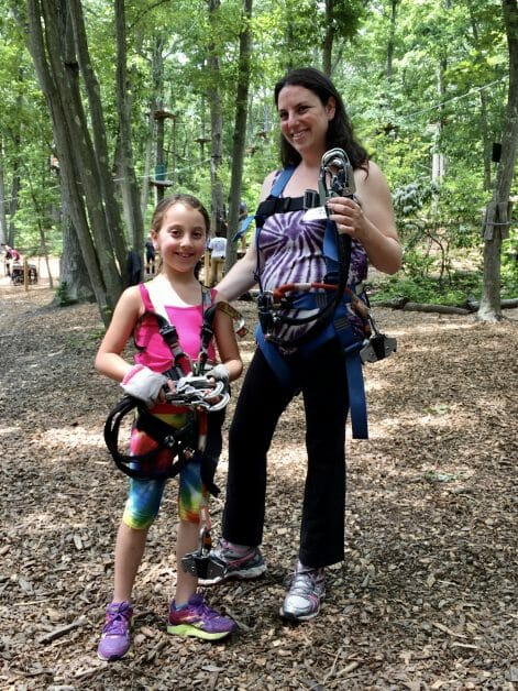 A mom and daughter at Adventure Park Long Island Zipline & Ropes Courses on Long Island.
