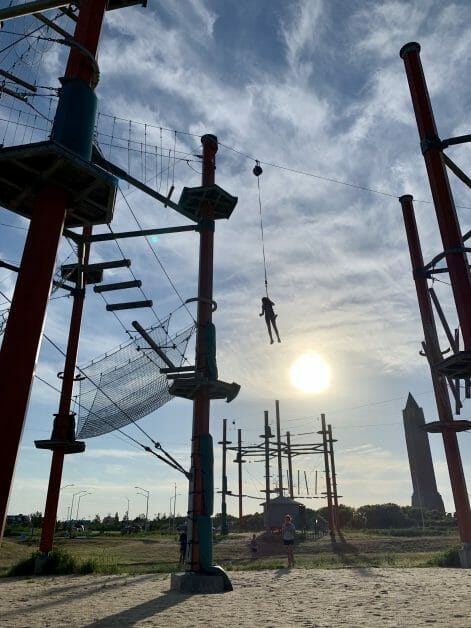 A girl on What to Fear Jump at Wild Play at Jones Beach. Zipline & Ropes Courses on Long Island.