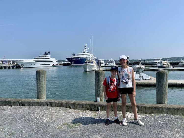Two kids standing at Mitchell Park Marina in Greenport