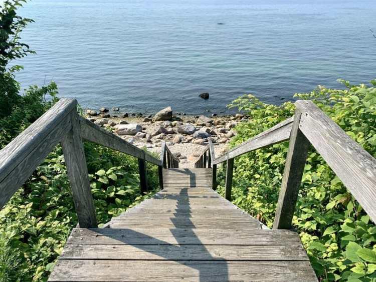 A Greenport beach stair case going down