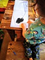 Revel making a painting of his favorite animal, an American Bison (Bison bison)