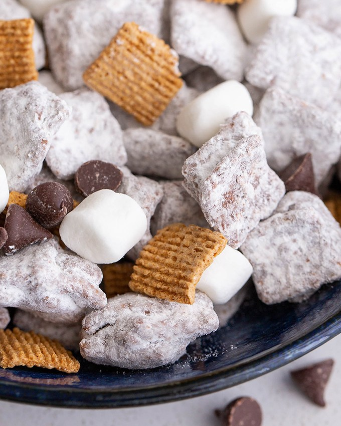 S'mores Puppy Chow (Muddy Buddies) #smores #puppychow #muddybuddies #snack #chocolate #peanutbutter #appetizer #appetizerrecipe #sweettreat #cereal #ediblegift #marshmallow   The Missing Lokness