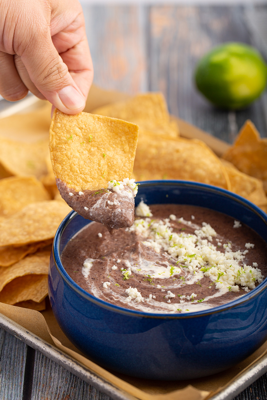 Cheesy Black Bean Dip | This is my copycat recipe of the bean dip at Trejo's Tacos. Creamy, savory, cheesy, little sweet, and little citrusy. #blackbean #copycatrecipe #trejostacos #beandip #cheese #cotija #jalapeno #lime #appetizer #appetizerrecipe #makeahed #dinner #partyfood | The Missing Lokness