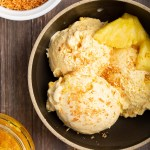 Pineapple Toasted Coconut Ice Cream | Coconutty & creamy w/ swirls of pineapple jam. By steeping toasted coconut in the custard, it brings little nuttiness & savoriness. Flavors are complex & robust. #pineapple #coconut #toasted #icecream #tropical #dessert #dessertrecipe #frozentreat | The Missing Lokness