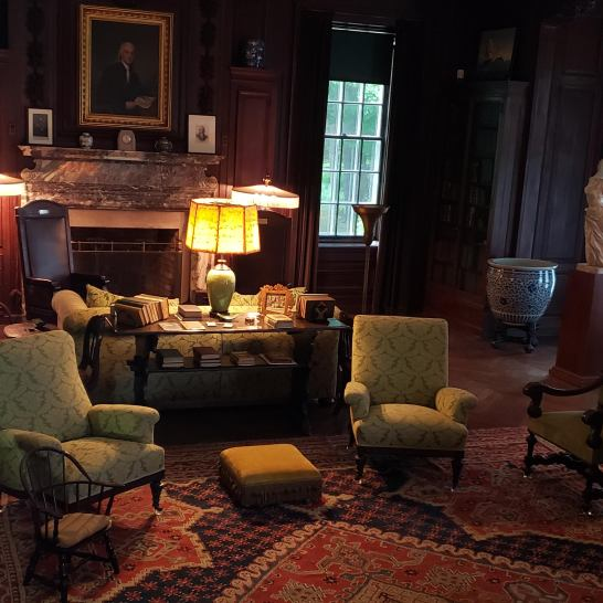 """The large sitting room where the Roosevelt's entertained. Note the President's """"chair with wheels"""" behind the chair to the left"""