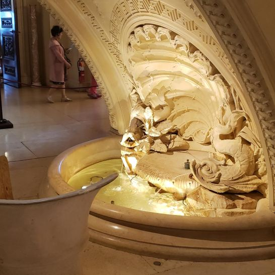 """Yes, this is a grotto under the grand staircase, with a fountain and """"cozy"""" seating!"""