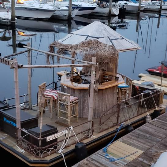 A Tiki Bar pontoon boat!
