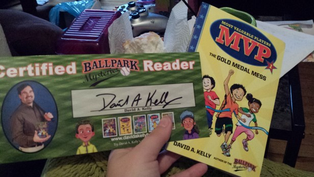 Most Valuable Players - The Gold Medal Mess written by David A. Kelly illustrated by Scott Brundage Signature and book pic