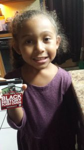 Surprising way to learn Black History by Mixed Family Life - Mixed Daughter holding cards
