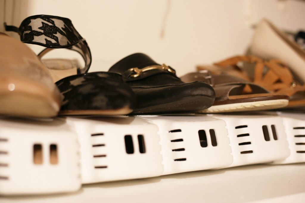 organized shoes with shoe slots to achieve a clean home