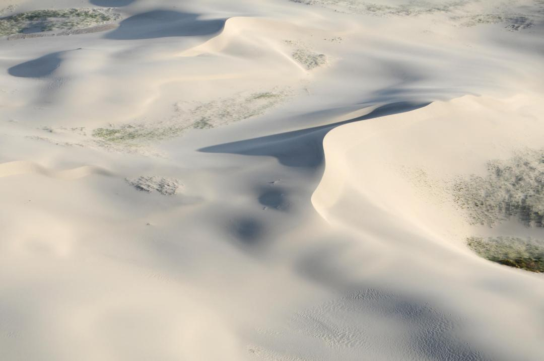 "An aerial photo of an area of the Western Killpecker Sand Dunes, which are the second longest ""living"" or moving sand dunes system in the world, after the Sahara."