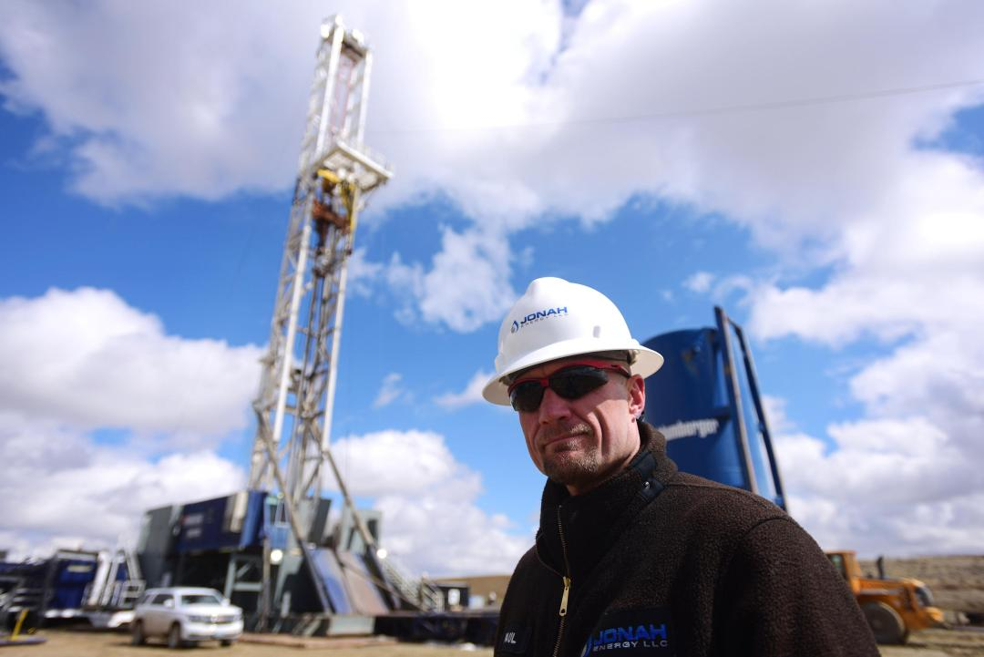 Paul Ulrich of Jonah Energy stands in front of a drilling rig in Sublette County, Wyo. Jonah Energy has more than 1,600 producing wells in Sublette County, most of them dotting a broad mesa that's prime sage grouse habitat