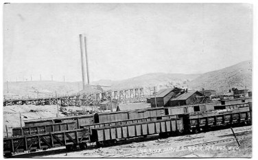 A Rock Springs coal mine, photographed in 1911. Mine No. 2 originally was owned by the Sweetwater Coal Mining Company which was acquired by the Central Coal & Coke Company of Kansas City, Mo. The mine employed about 100 men. The onset of the Great Depression reduced demand for coal. In January, 1931 the Company was forced into receivership.
