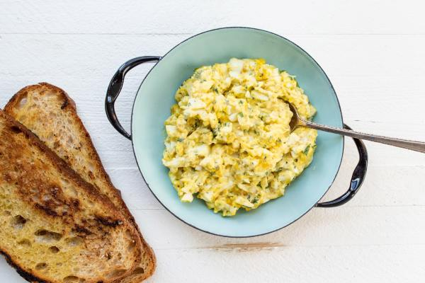 Egg Salad in a bowl with toast next to it
