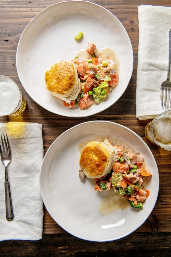 Two plates of Salmon and Vegetable Biscuit Pot Pie Casserole on a table