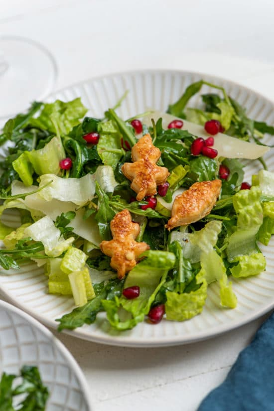 Green Salad with Pears, Parmesan and Pomegranate Seeds and Puff Pastry Croutons / Katie Workman / themom100.com / Photo by Cheyenne Cohen