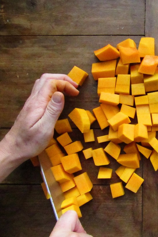 Cubing butternut squash / Katie Workman / themom100.com / Photo by Laura Agra