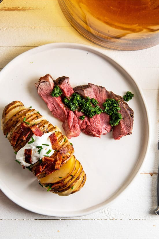 Standing Rib Roast with Kale Pesto and Loaded Hasselback Potato