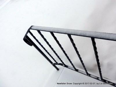 new snow on railing