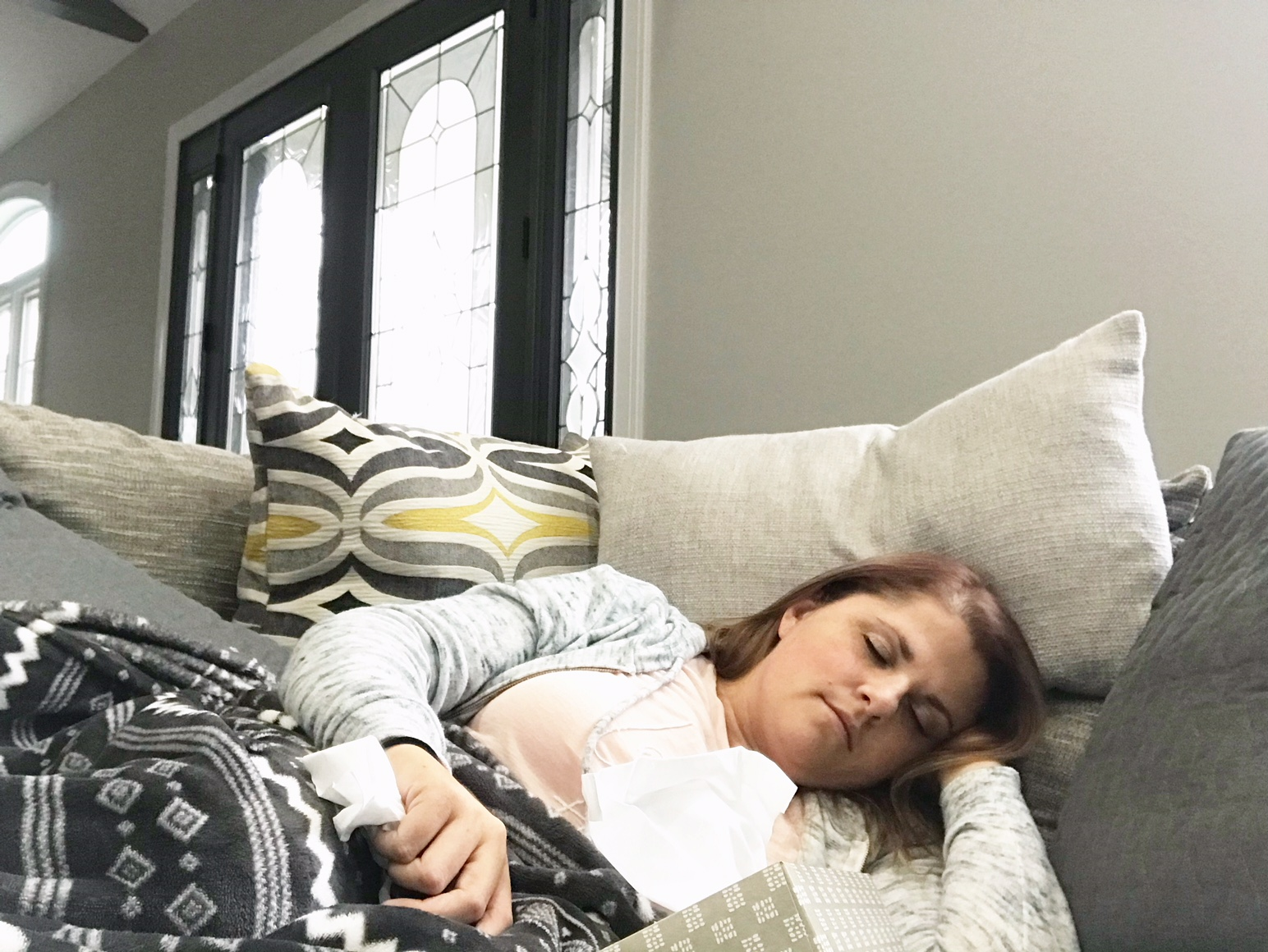 sick sleeping on couch