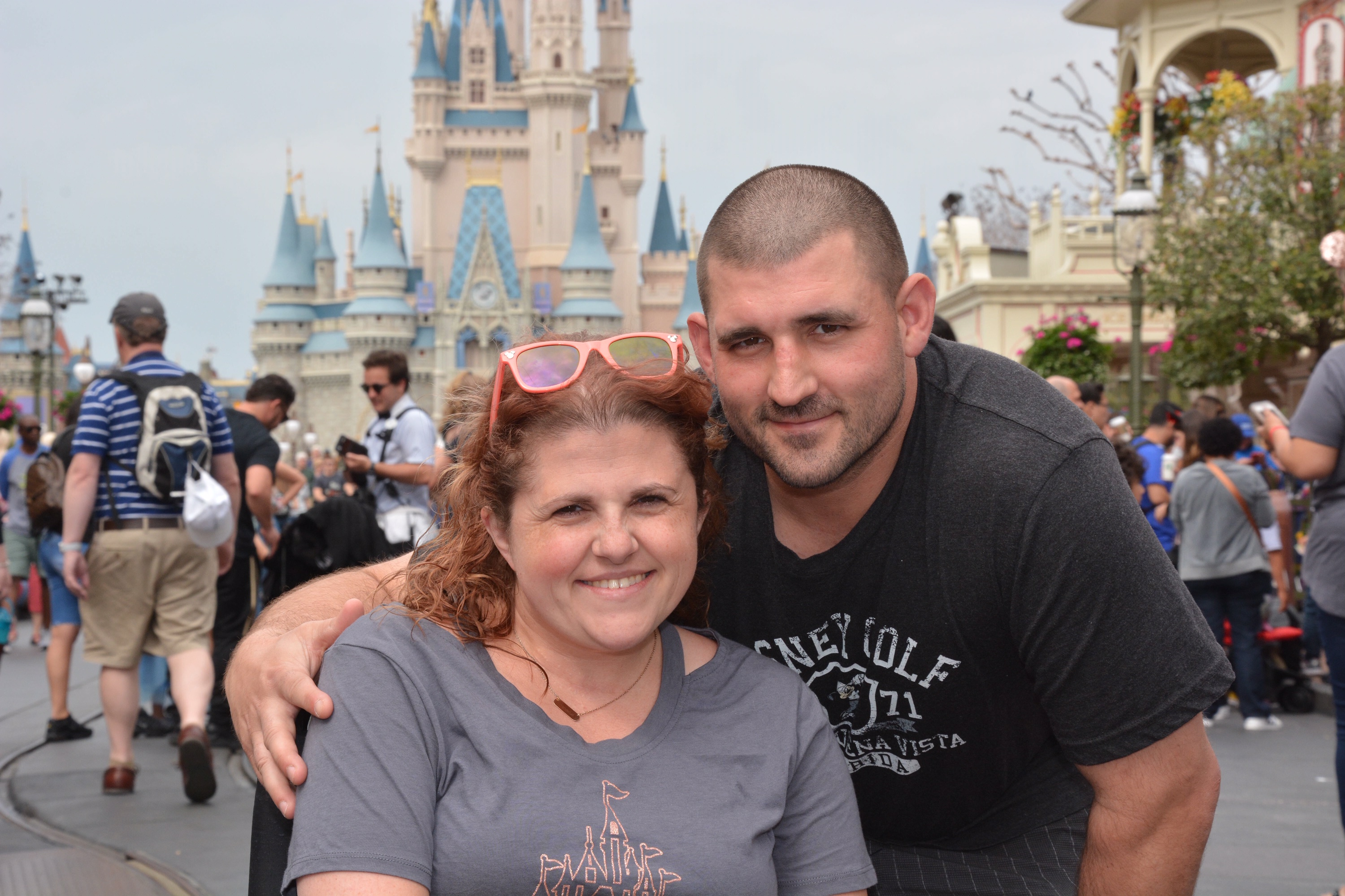 Couple in front of Cinderella Castle