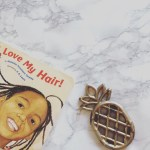 Pineapple teether toy with I Love My Hair book