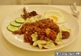 Nasi Goreng (P195): Stir-fried rice in kecap manis with chicken chunks and cabbages - served with shrimp paste, anchovies, cucumber slices, and a sunny side up egg.