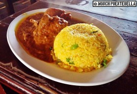 Chicken Biryani (P225): Chicken cooked in spicy korma sauce, served with spiced biryani rice.