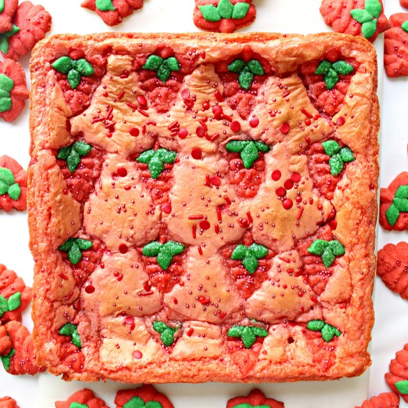 uncut pan of Strawberry Brownies with Strawberry Press Cookies baked on top for decoration